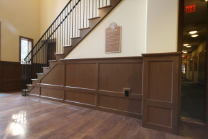 Metal stair railings and wood wainscoting