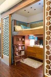 Custom built bed platform, dividing walls and shelves.